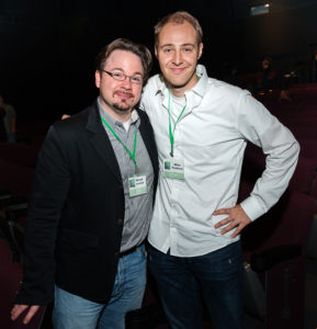L.A. Post Fest's MC, Michael Kammes, congratulates winner of the Best Film and Best Editing awards, Misha Tenenbaum.